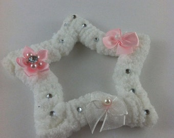 white fuzzy star hair clip and broach