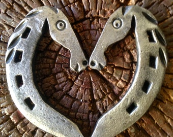Horseshoe heart with horse heads