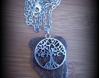 Necklace tree of life on wood
