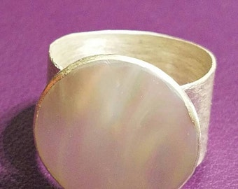 Sterling silver and mother of pearl cabochon ring in a sterling silver bezel setting