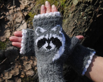 Knitted mitts with raccoons