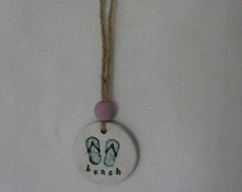 Blue flipflops beach style clay tag
