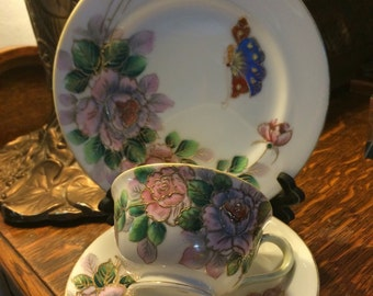 Porcelain Hand Painted Tea Cup, Saucer and Dessert Plate.