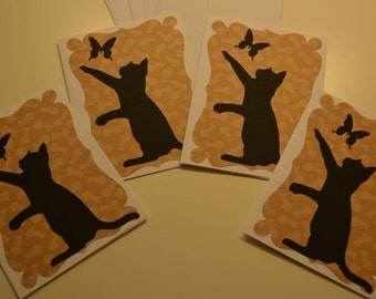 Set of 4 handmade blank note cards, featuring kitten chasing butterfly. Includes envelopes.