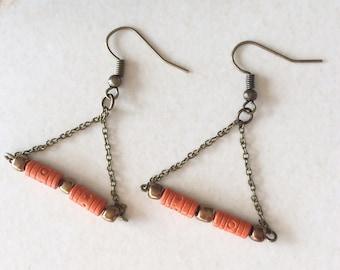 Ethnic earrings in bronze metal and orange beads