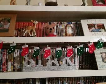 Mini Christmas stocking garland .
