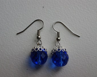 Blue glass bead earrings with silver cap
