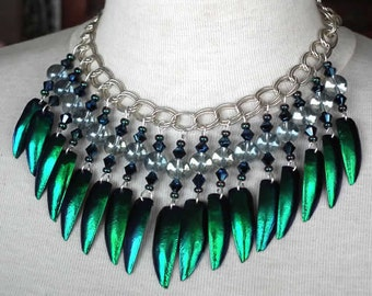 Chest Boho necklace made of blue-green beetles elytras  on a silvercolor chain with   glassbeads