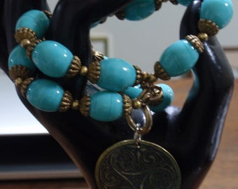 Blue Glass colored bead  and brass bracelet