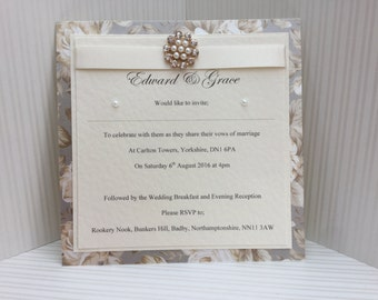 Handmade Floral and Pearl-embellished Wedding Invitation sample