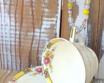 Vintage teacup hanging bird feeder