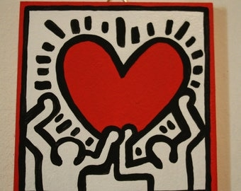 Little men with heart-hand playing Keith Haring