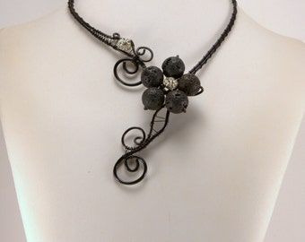 Black wire necklace with volcano flower.