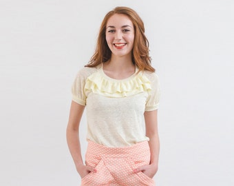 Round neckline ruffle ecru color T-shirt