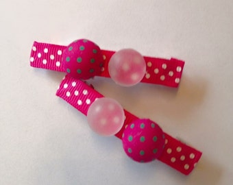 Pink hair clips with white dots