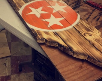 Torched wooden state of Tennessee sign