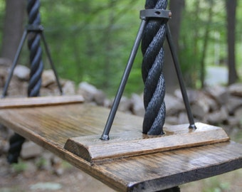 Wonderful garden rope swing seat.