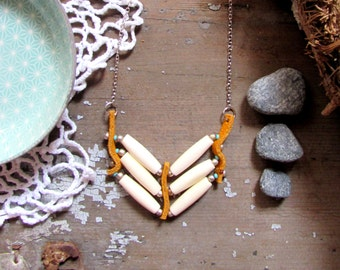 Native American-inspired pendant necklace with turquoise and bone beads-jewel Native American hairpipe necklace style
