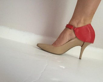 Extravagant red shoe-heel cover.