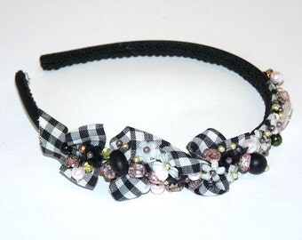Black headband decorated with crystals, beads and glass flowers