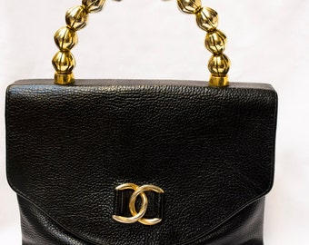Vintage handbag with golden beaded handle