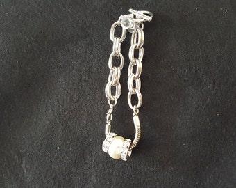 Swarvoski Pearl with 2 Round Swarvoski Crystals set on a silver bracelet