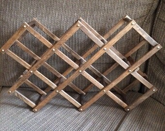 Vintage accordian wine rack from the ( 1960's). I'm just guessing here.