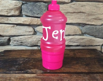 Water bottle with snack cup