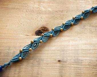 Blue macrame bracelet with gold beads