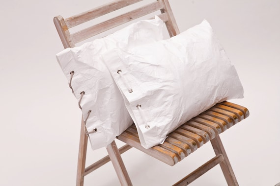 Decorative pillow with ties made out of Tyvek cushion