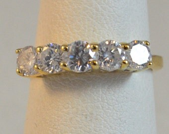 5 stone diamond band in yellow gold