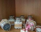 Mini glass jars containing mini homemade Wax Soya heart melts in fragrance Baby Powder