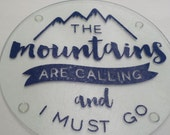 The Mountains Are Calling Round Cutting Board