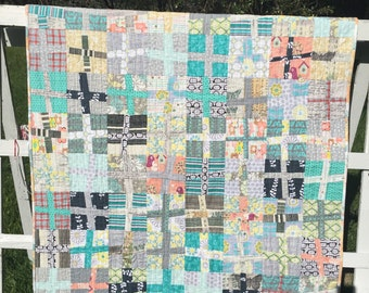 Modern plus quilt, wonky cross quilt, lap quilt, quilted throw