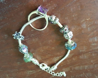 Beaded bracelet with violet stone ring