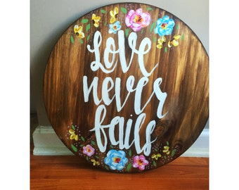 "Wood Circle ""Love Never Fails"""