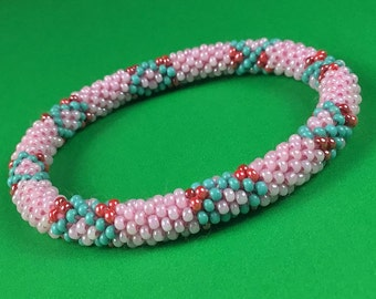 Lifted Hope Nepal Glass Bead Bracelets Handmade by Ramila Beads. Pink with Red and Blue Flowers.
