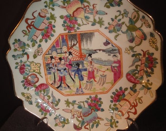 i  have to sell three(3) fantastic  design  chinese plates dia size=22cm all signed