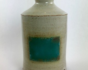 soap dispenser with turquoise square