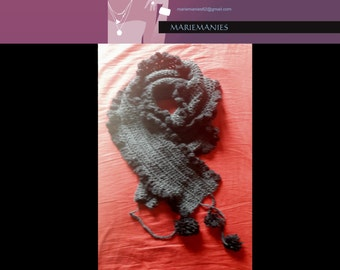 Scarf crocheted by hand and its ponpons