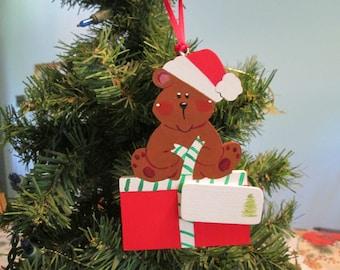 bear ornament sitting on gift
