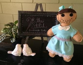 Hand stitched felt dolls