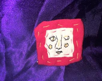 Hand stitched pin