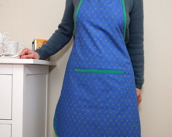Kitchen apron in blue cretonne dotted with small yellow flowers grass green link