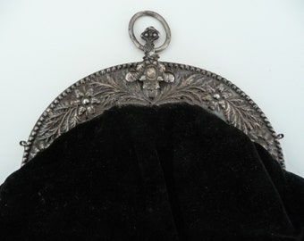 Antique silver frame and velvet bag with an original mirror inside