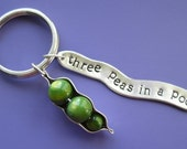 3 sets of 'three peas in a pod' keychains