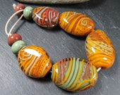 Sedona encased lampwork pebble bead set