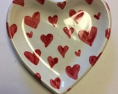 Red, pink, and white heart shaped dish. 5 inches by 5 inches.