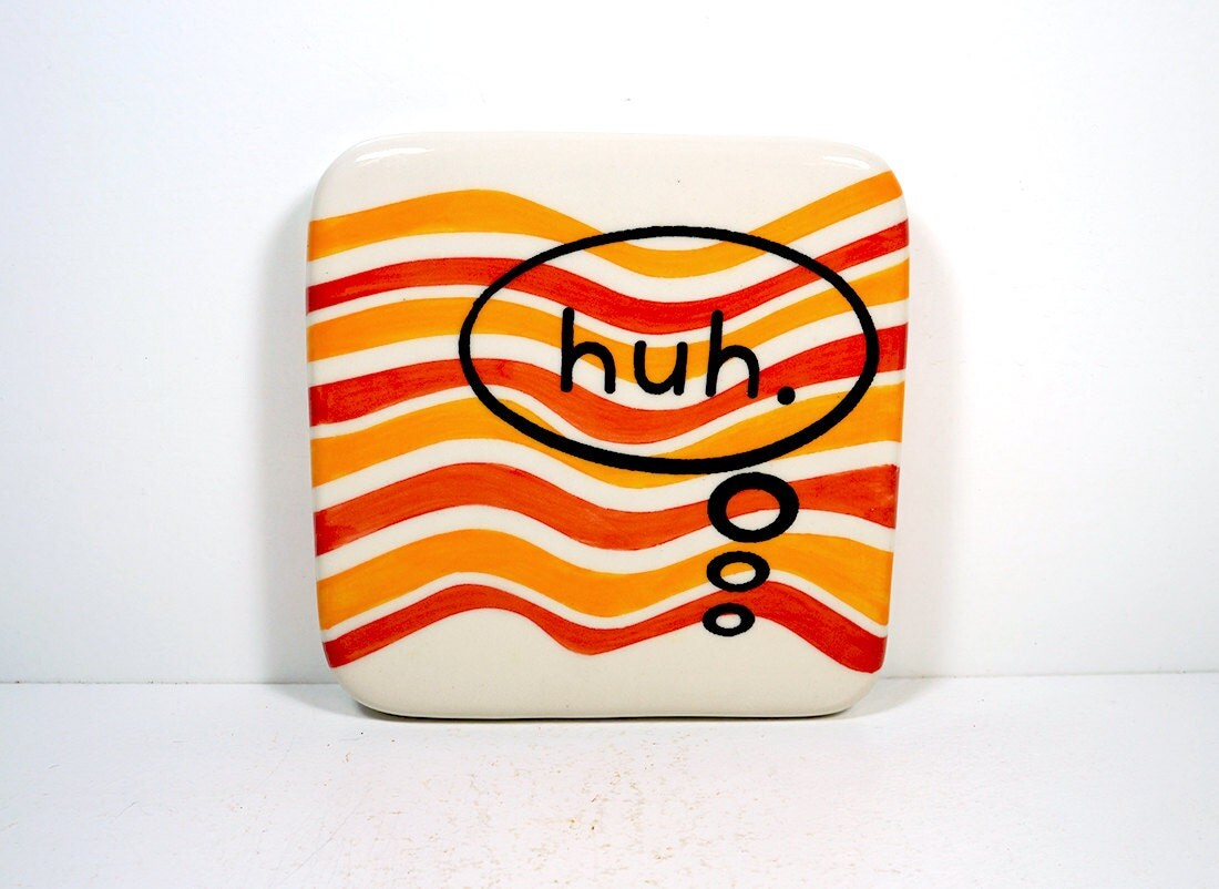 """tile with """"huh."""" thought bubble on orange and red-orange waves. Ready to ship."""