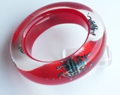 Red lucite bangle with exotic real glowing insects